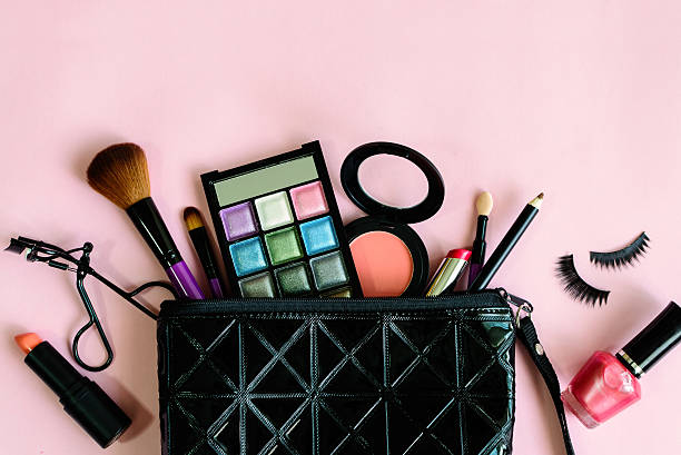 make up with cosmetics and brushes isolated on pink background stock photo