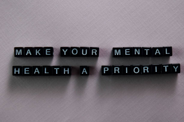 Make your mental health a priority on wooden blocks. Motivation and inspiration concept stock photo