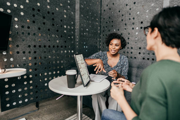Make Your Small Business Ready to Succeed. Entrepreneur Hispanic women working in the office and having business meeting stock photo