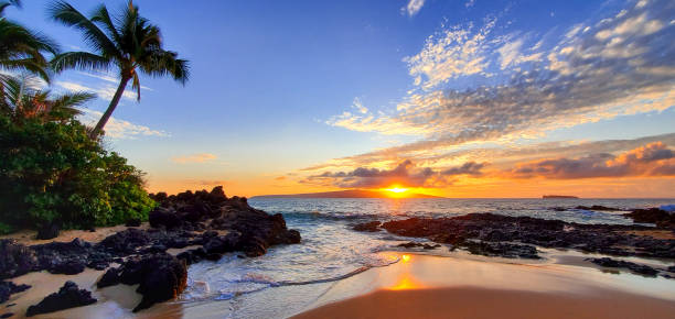 Makena Secret Beach at sunset in Maui, Hawaii Makena Secret Beach at sunset in Maui, Hawaii bay of water stock pictures, royalty-free photos & images