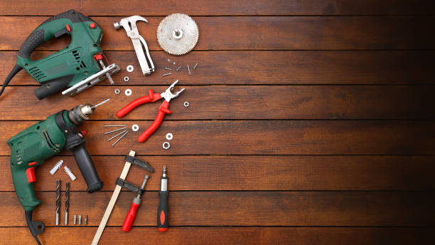 DIY Maker Background with Hand Tools on Wood Table
