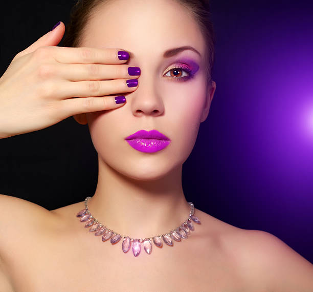 Makeup and manicure. black background Makeup and manicure. black background pink nail polish stock pictures, royalty-free photos & images