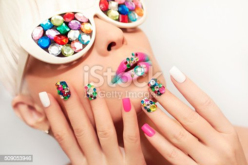 istock Makeup and manicure with crystals. 509053946