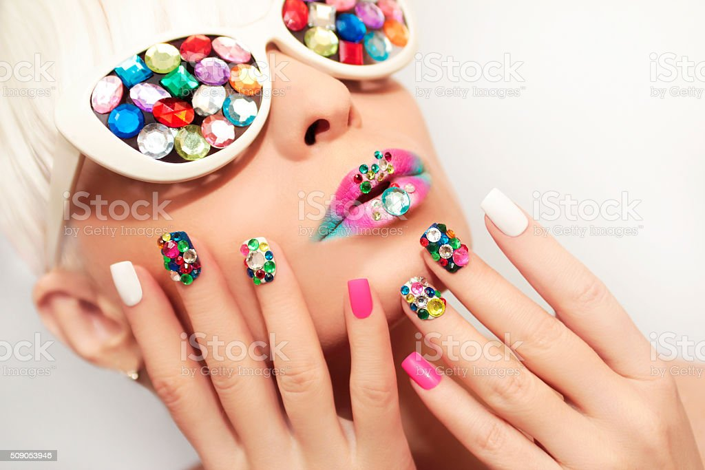 Makeup and manicure with crystals. stock photo