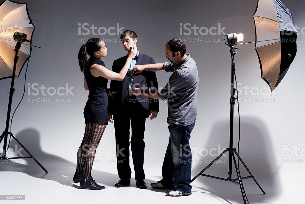 Makeup Artist and Stylist Working on Model stock photo