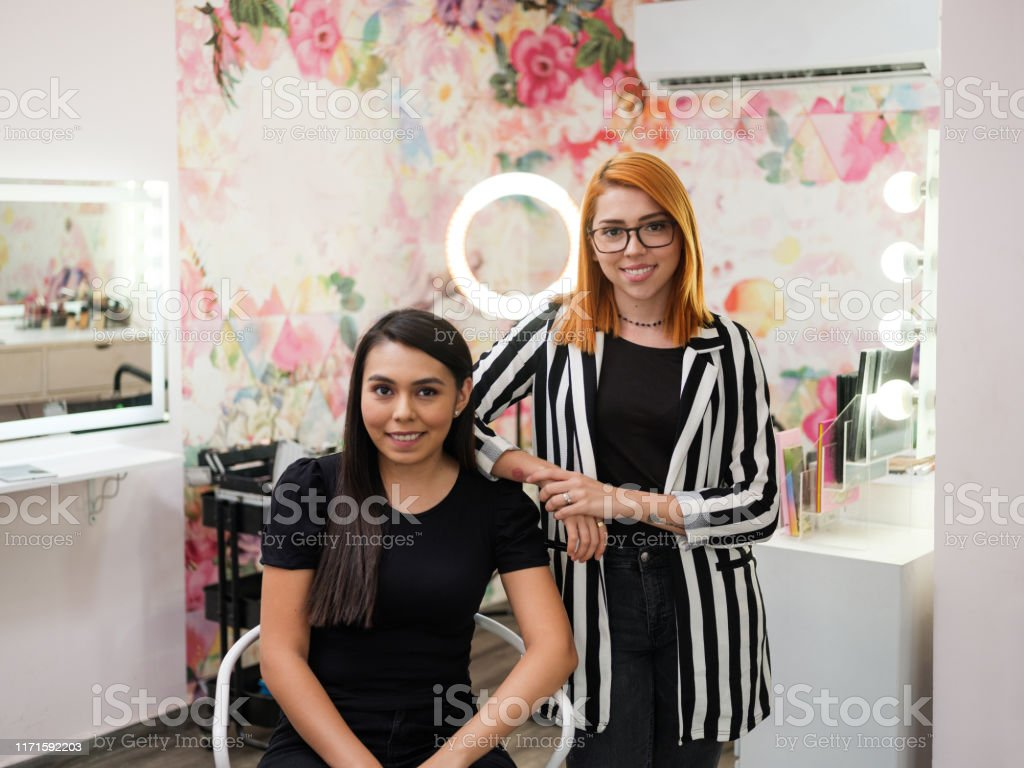 Makeup Artist And Trainee Smiling At Camera In Beauty Salon Stock Photo Download Image Now Istock