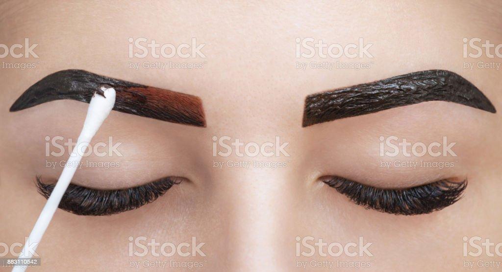 Makeup Artist Applies Paint Henna On Eyebrows In A Beauty Salon