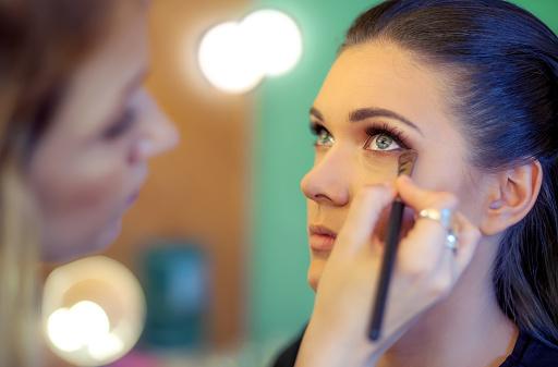 istock Makeup artist applying eyeshadow 636636048