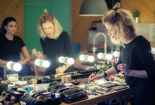 istock Makeup artist applying eyeshadow 636637412