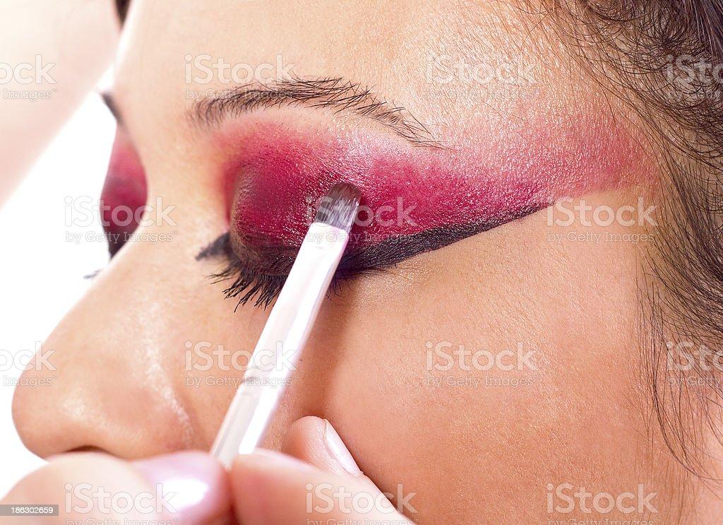 Make-up artist applying make up on model royalty-free stock photo