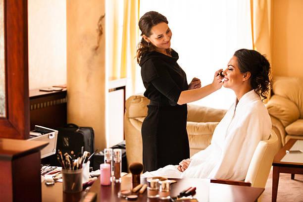 Make-up artist applying makeup stock photo