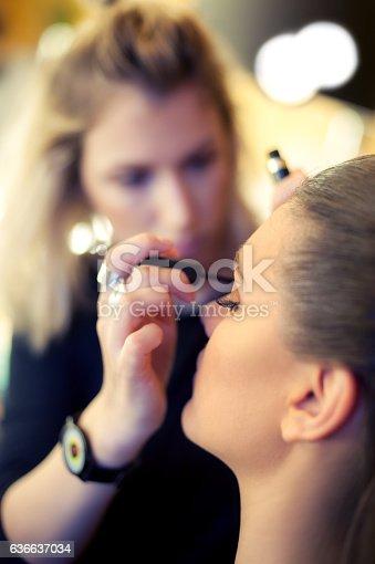 istock Makeup artist applying mascara 636637034