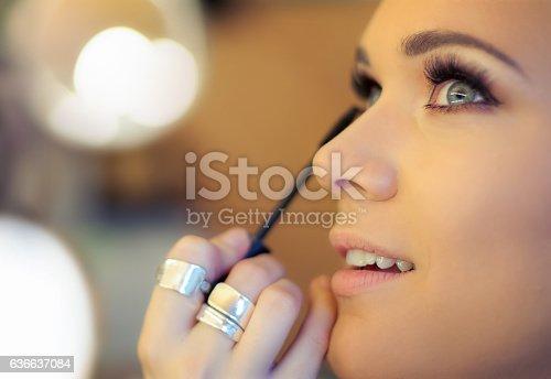 istock Makeup artist applying mascara 636637084