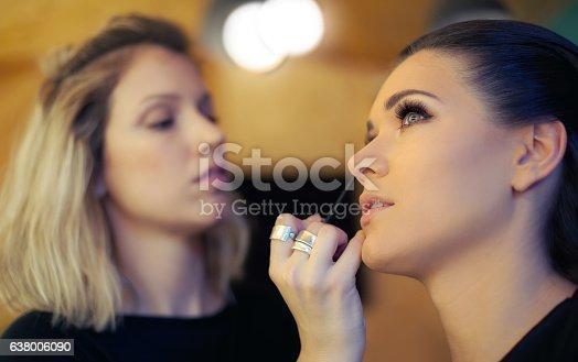 istock Makeup artist applying mascara 638006090