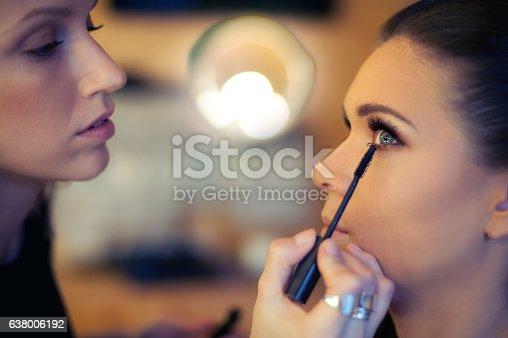 istock Makeup artist applying mascara 638006192