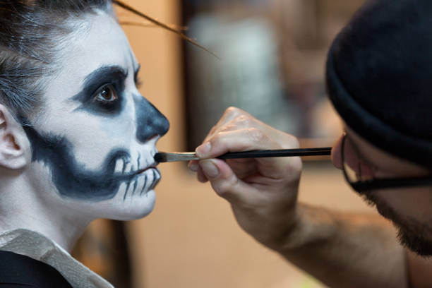 Makeup artist applying skeleton makeup on a woman picture id803363002?b=1&k=6&m=803363002&s=612x612&w=0&h=orzqv8cv8ceurlgnq515rtxjd01gybnjb1 w52jhfvg=