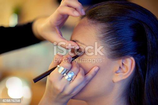 istock Makeup artist at work 628876258