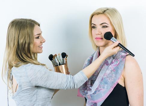 Makeup artist with client