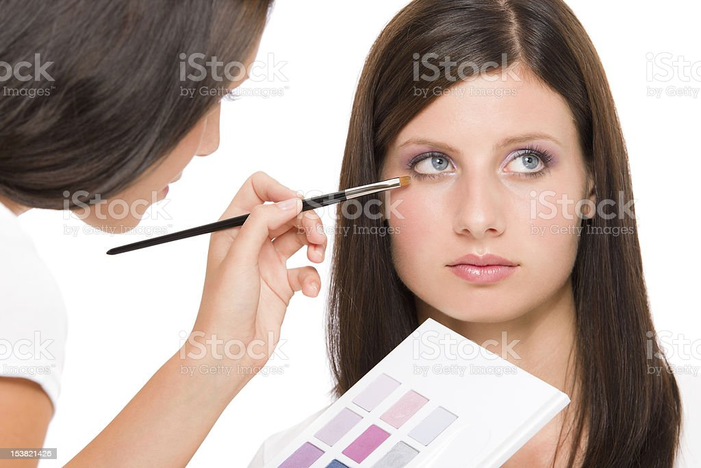 Make-up artist woman fashion model apply eyeshadow royalty-free stock photo