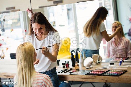istock Make-up artist work on pretty woman 959843080