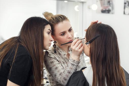 makeup artist working in studio