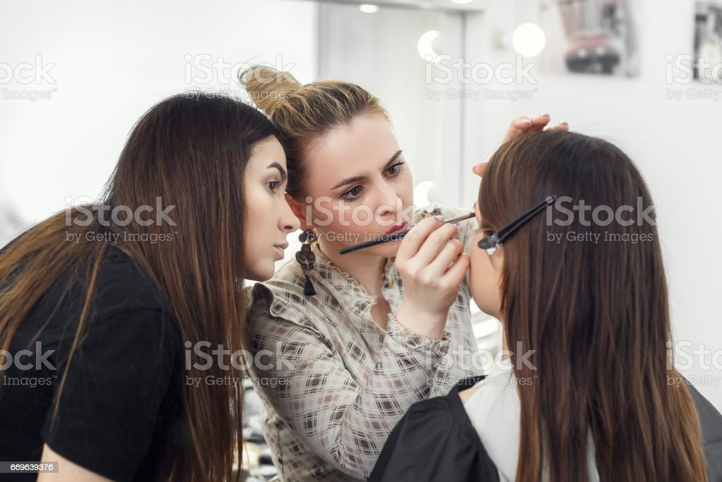 makeup artist working in studio stock photo