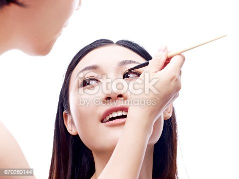 istock makeup artist working on a fashion model 670280144