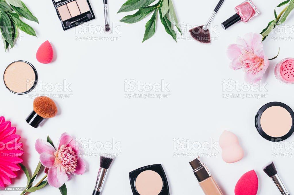 Makeup background of face powder, nail polish, foundation, sponge...