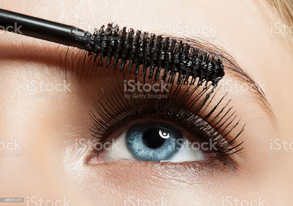 Make-up blue eye with long lashes with black mascara stock photo