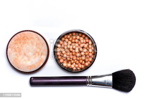 Makeup blush and balls with brush on white background isolated