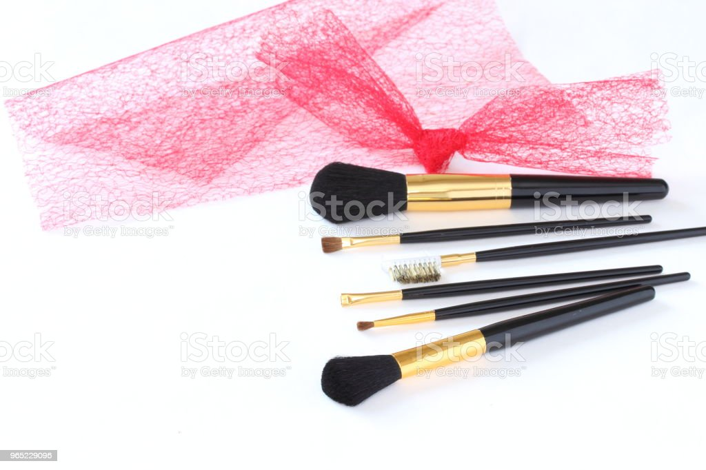 make-up brush set  and red tulle royalty-free stock photo