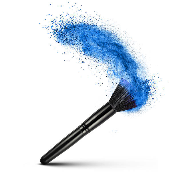 makeup brush with blue powder isolated stock photo