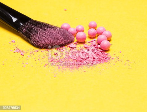 istock Makeup brush with crushed and whole shimmer blush balls 507576534