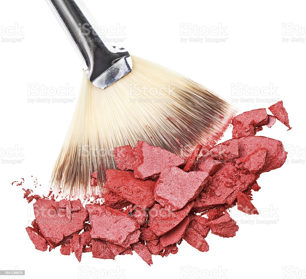 Makeup brush with red crushed eye shadow, isolated royalty-free stock photo