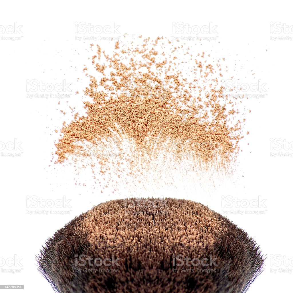 Makeup brushes and powder in motion royalty-free stock photo