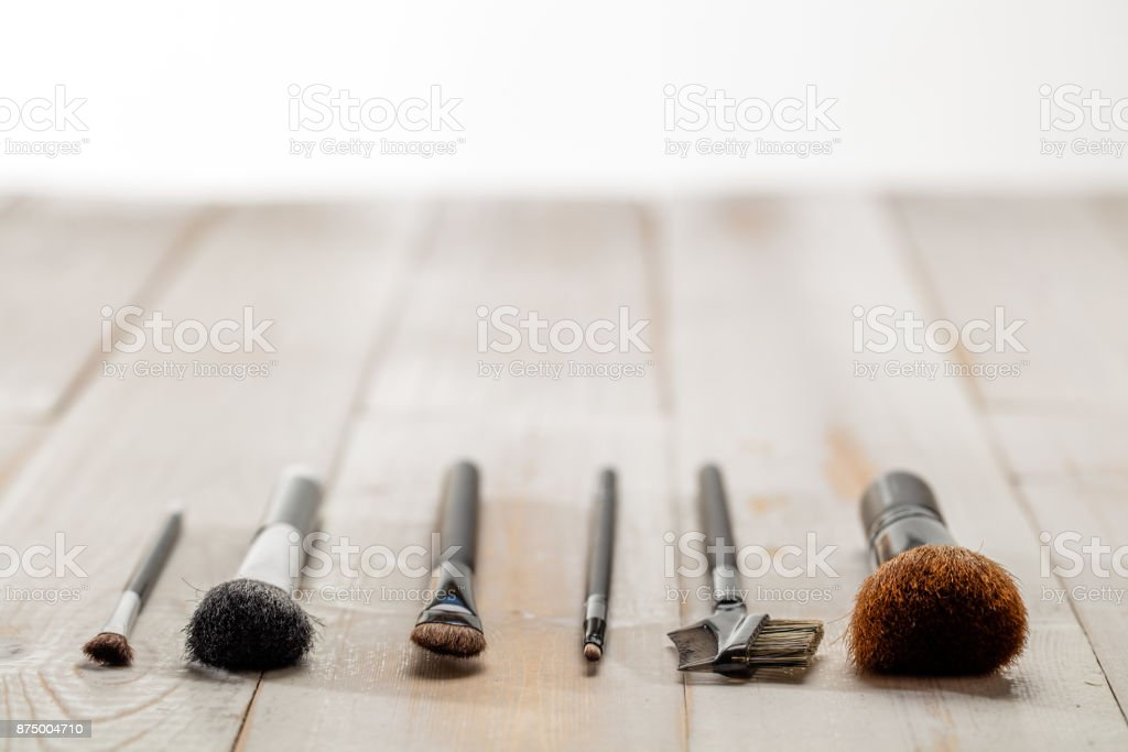 makeup brushes in foreground for concept of elegance, copy space stock photo