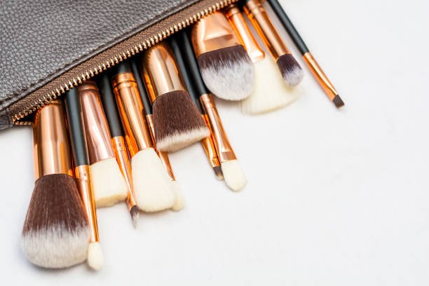 Makeup brushes in white background with copyspace stock photo
