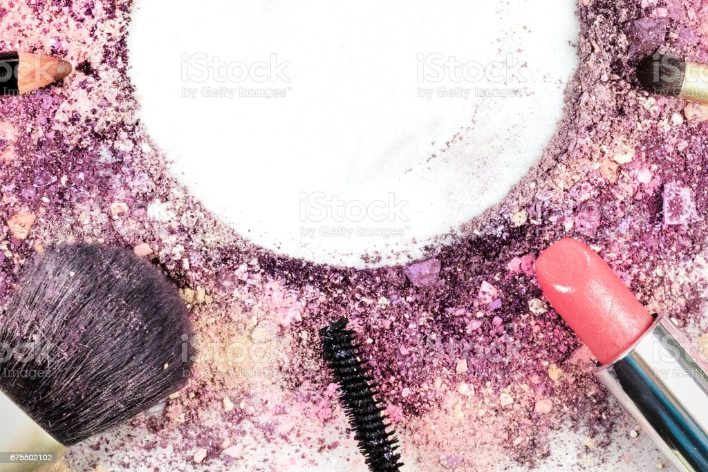 Makeup brushes, lipstick, and pencil with powder and copyspace royalty-free stock photo