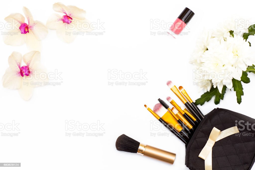 Makeup Brushes Pink Nail Polish Orchid And Chrysanthemum Flower On A
