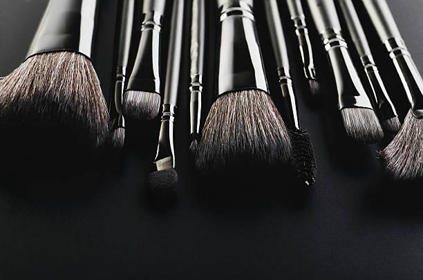 Makeup brushes set close-up on a black background horizontal, sp – Foto