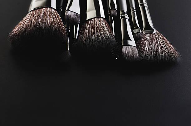 Makeup brushes set on a black background horizontal – Foto