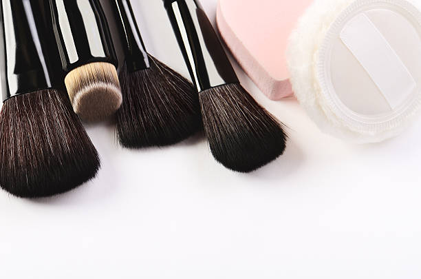 Makeup brushes, sponge and powder puff on a white background – Foto