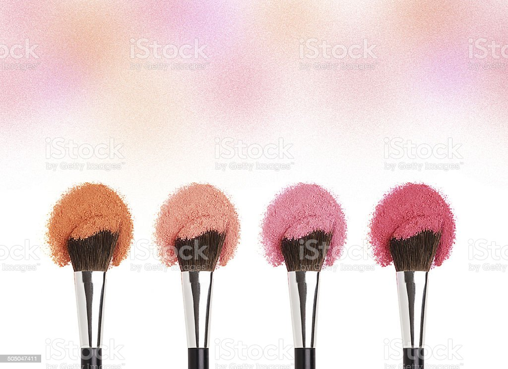 Makeup brushes with face eye pink shadow/cheek powders stock photo