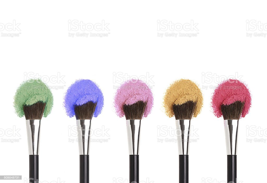 Makeup brushes with face eye shadow powders stock photo