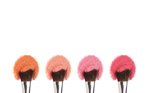 Makeup brushes with face eye shadow/cheek powders isolated on white with copy space blusher make up stock pictures, royalty-free photos & images
