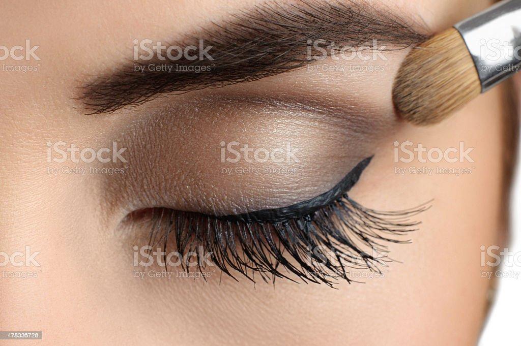 Makeup close-up. Eyebrow makeup, brush. stock photo