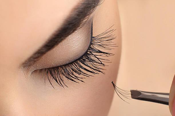 Makeup close-up. Eyebrow makeup. Eyelash extension. Makeup close-up. Eyebrow makeup. Eyelash extension. false eyelash stock pictures, royalty-free photos & images