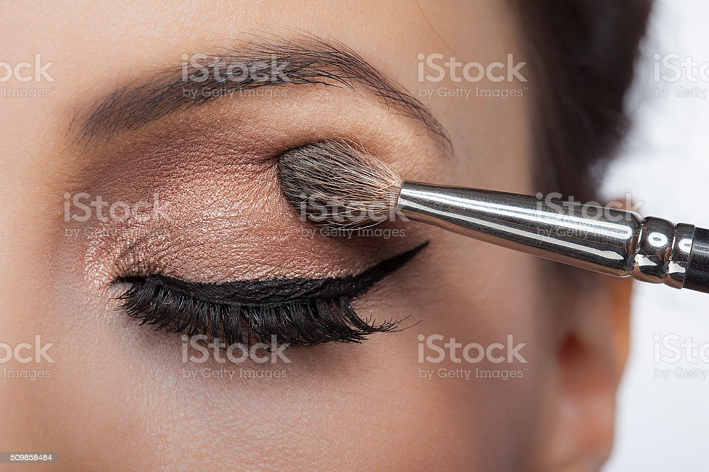 Makeup close-up. Eyebrow makeup, long eyelashes, brush. stock photo