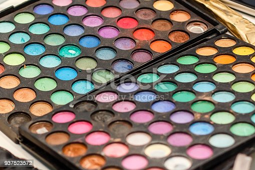 istock Make-up colorful eyeshadow palettes isolated on black background 937523572