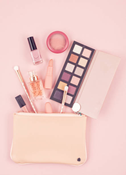 Makeup cosmetic products over pastel pink background, flat lay, top view stock photo